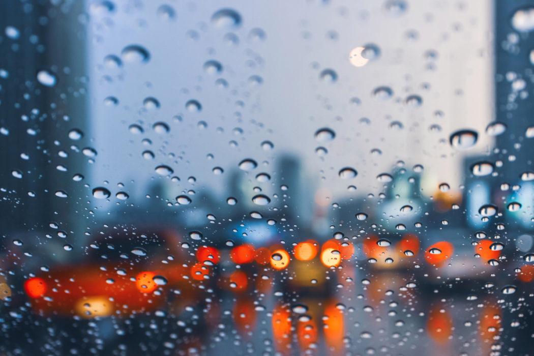 Rain On Glass With Car Lights